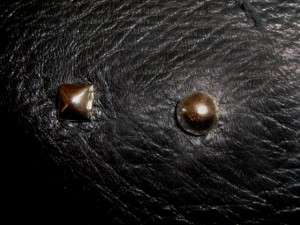 "¼"" pyramid studs; shiny nickel finish 5/16"" round cone studs; shiny nickel finish"